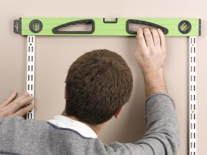 Measure and level the twin slot shelving uprights