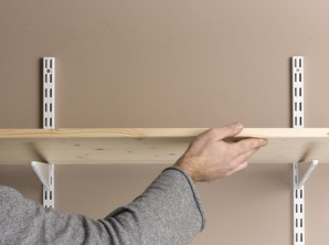 Adding the shelves to the twin slot shelving uprights and brackets